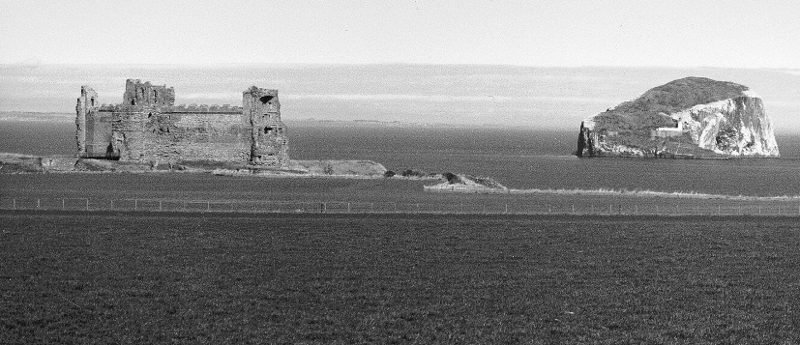 Bass Rock and Tantallon Castle, photographed from the south near Auldhame, 1989. (David Moody)