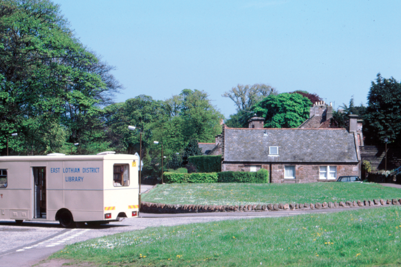 East Lothian District Library van leaving Ruthven Road, Dirleton. The cottage beyond is Woodend.