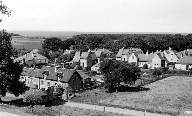 Houses in Dirleton village viewed from the castle. In the foreground are Castlemains farm cottages. Next to these is the old bakehouse which was a Co-op grocery store till the mid 1960s. (A&J Gordon)