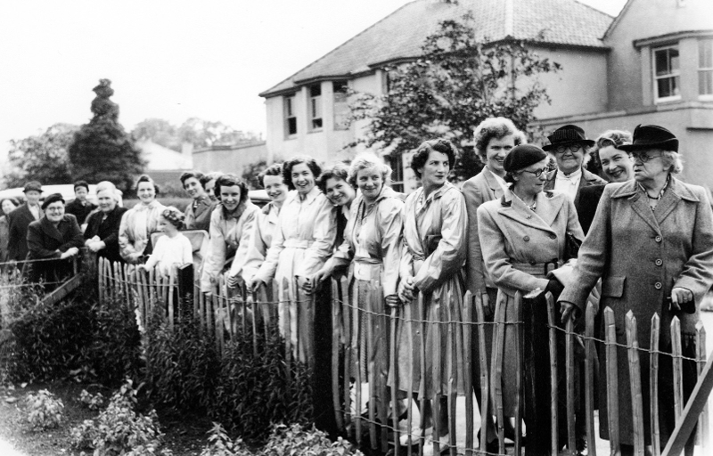 Waiting for the bride. The women of the village spectating at a wedding in 1951 (A&J Gordon)